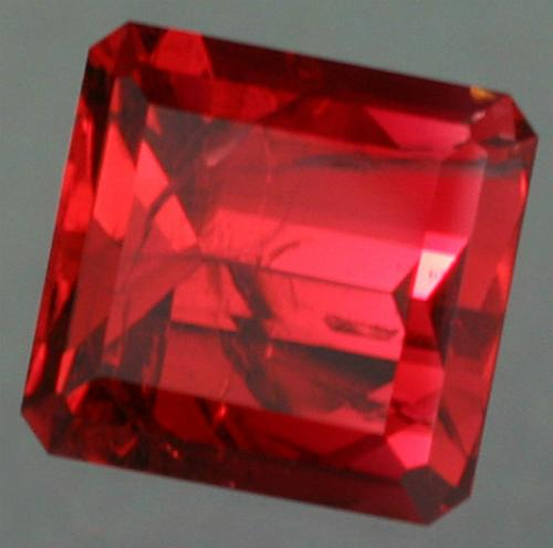 Rare red beryl (bixbite), cut by John Dyer & Co. Photo by Lydia Dyer.