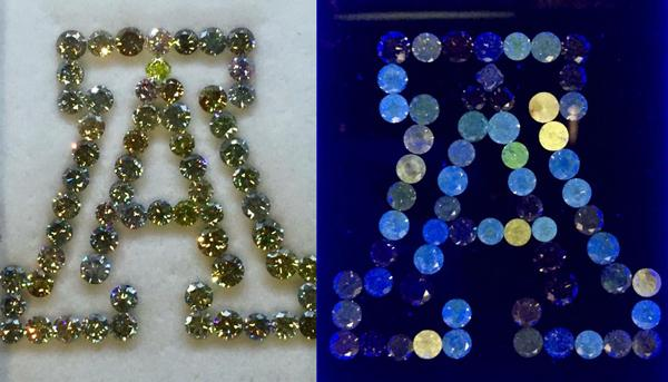 Fluorescent Gems: Natural coloured diamonds laid out in UofA logo by Sean Milliner